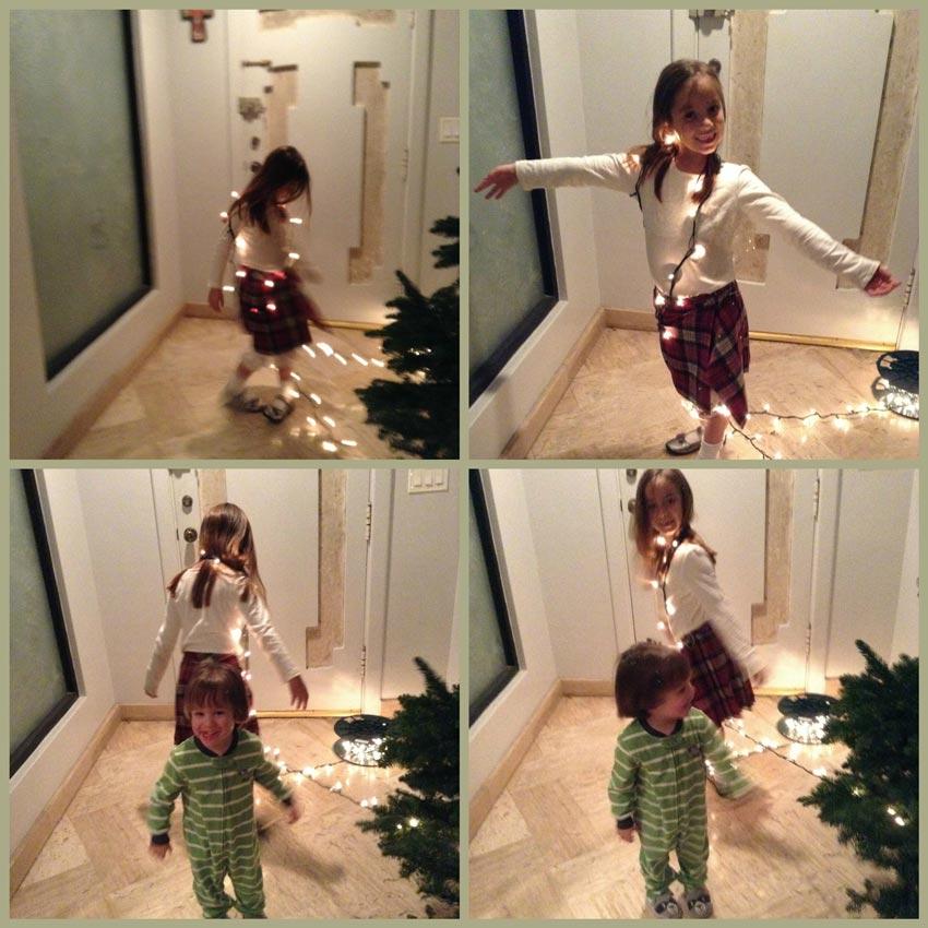 Navidad-Christmas-Arbol-Navideño-los-niños-juegan-con-los-focos